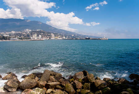 Yalta embankment. View of the lighthouse photo