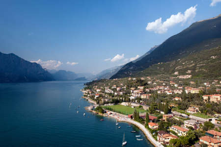 Lake Garda is the largest lake in Italy. It is located in Northern Italy, about half-way between Brescia and Verona, and between Venice and Milan. Stock Photo - 8792645