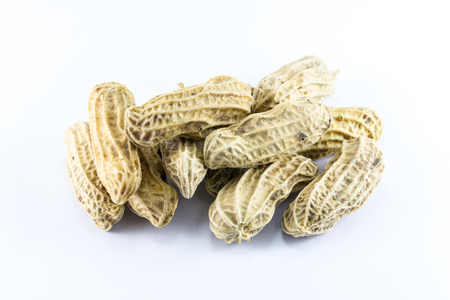 hulled: Closeup of peanuts on white background Stock Photo