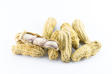 hard core: Closeup of peanuts on white background Stock Photo