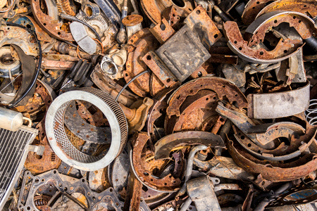 Pile of car parts with rust
