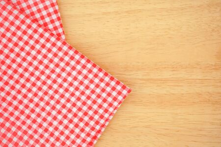 Classic pink plaid fabric or tablecloth on wood desk with copy space Фото со стока
