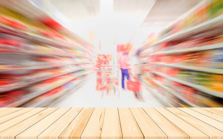Wood table or wood floor with supermarket blur background for Product display