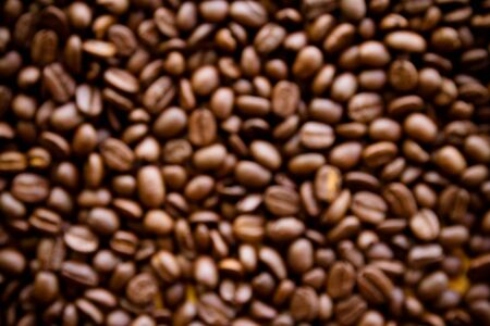 abstract blurred background of coffee beans Фото со стока