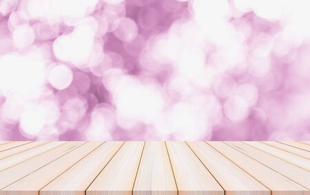 Wood table or wood floor with abstract pink bokeh background for product display Фото со стока
