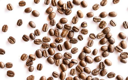 Roasted coffee beans arrange on white background