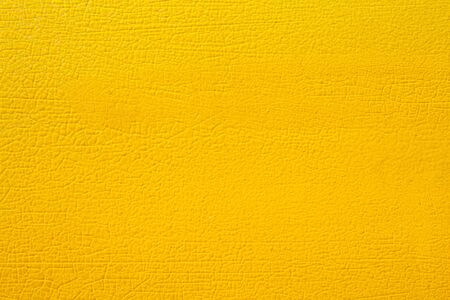 Abstract background of Cracked yellow color on aluminium surface. Фото со стока
