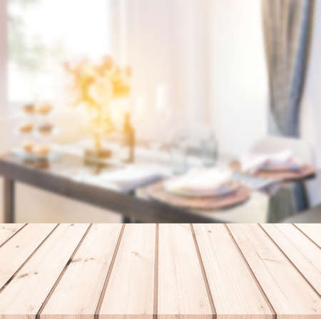 Empty wood table with blur background of dining table for products display