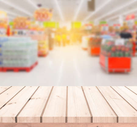 Wood table or Wood floor with supermarket or superstore blur background for product display