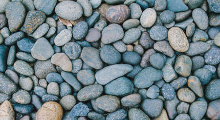 River stone or Pebbles stone background with vintage filter