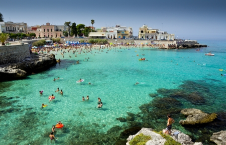 vacationers: Lecce, Italy - July 29, 2012  Vacationers enjoying the turquoise waters of resort town Santa Maria al Bagno