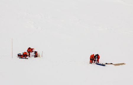 A group of polar Scientists working over an ice floe in the polar seas