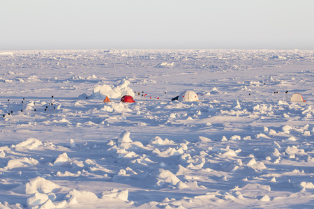polar station: Tent and domes of an Ice camp over an ice floe in Antarctica