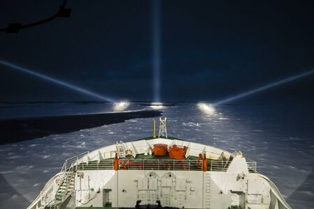 cruising: Icebreaker ship cruising at night by the aid of night-piercing projectors in the polar sea