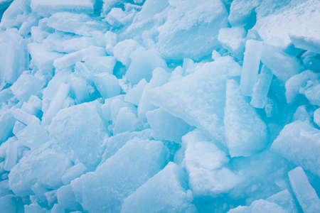 edge of the ice: Cracked blue ice on the edge of ice floes in Antarctica Stock Photo
