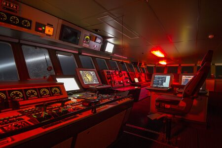 Bridge of a polar research vessel while cruising at night during a snow storm