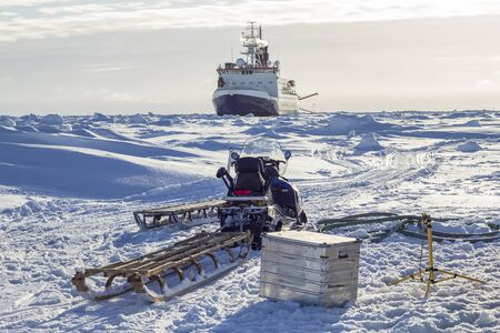 Research icebreaker and snowmobile with sledges while setting up an ice camp Reklamní fotografie