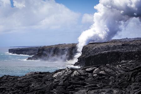 Lava from Kilauea pouring to the ocean at Hawaii Volcanoes National Park, Big Island, Hawaii Stock Photo
