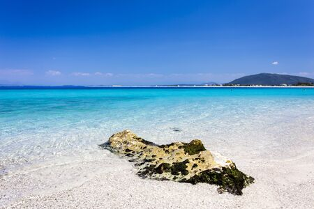 Turquoise waters of Agios Ioannis Beach of Lefkada, Greece, located at the Ionian Sea.