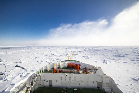Frozen polar sea and vast ice floes from the bridge of a research icebreaker ship