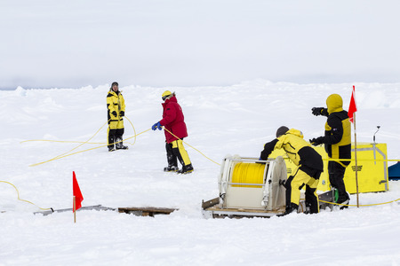 Weddell Sea, Antarctica – September 19, 2013: Scientists from a research icebreaker are establishing a remotely operated vehicle (ROV) camp over an ice floe to explore under ice algal growth Redakční