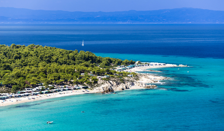 Turquoise waters of Sithonia,  Halkidiki, Greece is apopular destination for locals and foreigners. Stock Photo