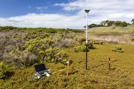 Scientific instruments used during a field work at a coastal saltmarsh to understand inundation and its impact on blue carbon stocks