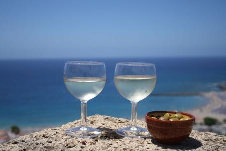 vistas: Glasses of white wine with view of Playa las Vistas Stock Photo