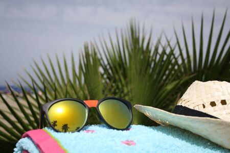 las vistas: Beach towel and sunglasses Playa las Vistas Stock Photo