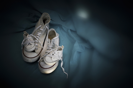 symbolics: Sneakers Family-two different sneakers like symbol of mother and father and two small sneakers like symbol of two children