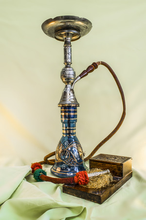 Nargile-Hookah With Engraved Equipment on Green Drapery
