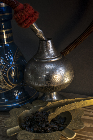 Nargile-Hookah With Engraved Equipment and Tobacco in Dark Environment Stock Photo