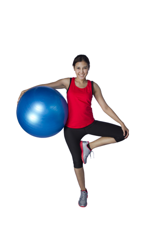 sport girl doing  exercise with fitness ball on wite background photo
