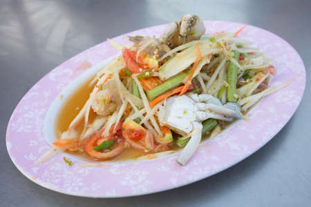 thai food somtam ( green papaya salad spicy thai style ) photo