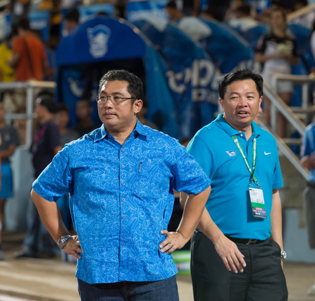 buriram: CHONBURI THAILAND- AUGUST 13:Wittaya Khunpluem(right )club president of Chonburi Fc and brother in Thai Premier League (TPL) between Chonburi Fc(blue) vs Buriram United(white) on August 13, 2014  at Chonburi Stadium in Chonburi Thailand