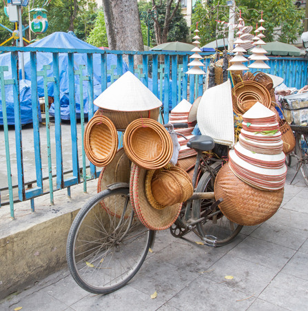 conical hat: Asian conical hats decorated on bicycle