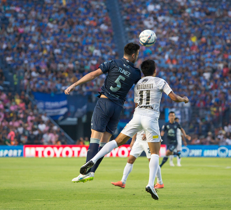april 15: BURIRAM THAILAND-APRIL 15:Andres Tunez(blue) in Thai Premier League (TPL) between Buriram United(blue) vs Chonburi FC(white) on April 15, 2016 at I-mobile Stadium in Buriram Thailand