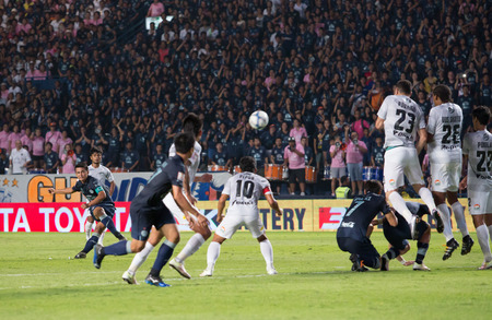 april 15: BURIRAM THAILAND-APRIL 15:Unidentified Players in Thai Premier League (TPL) between Buriram United(blue) vs Chonburi FC(white) on April 15, 2016 at I-mobile Stadium in Buriram Thailand