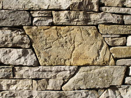 raspy: Rough stone wall with large stone space in the midlle