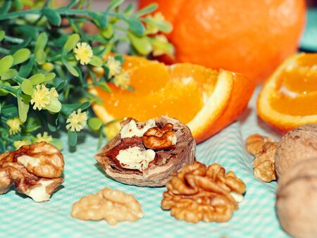healthy snack: Healthy snack with walnuts and oranges