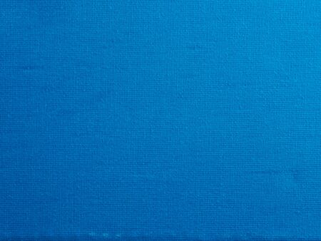 Bright blue canvas texture background Imagens
