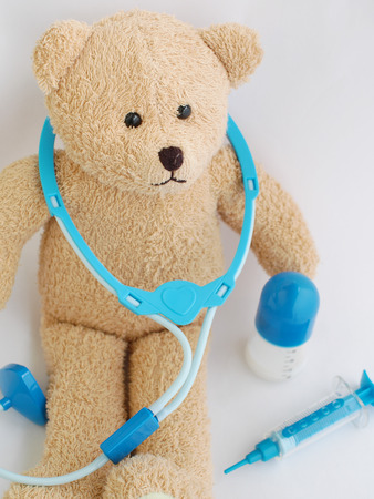 doctor toys: A teddy bear with little doctors kit Stock Photo