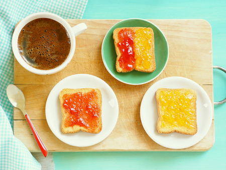 trencher: Zwiebacks with jam and cup of coffee for continental breakfast on wooden trencher