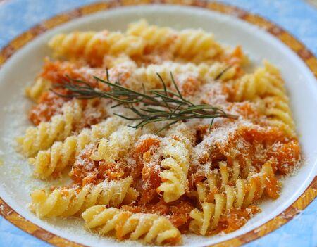 short pasta: Italian short pasta fusilli with pumpkin sauce and rosemary herb