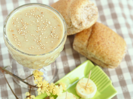 sesame seeds: Soy milk smoothie with banana garnished with sesame seeds