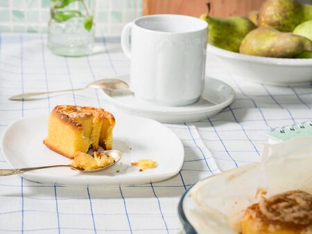 corn flour: Breakfast set with mixed wheat and corn flour roll buns and black tea on white checkered table cloth