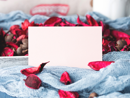 Blank paper note for Valentines or mother day. Background with dried flower petals Stock Photo