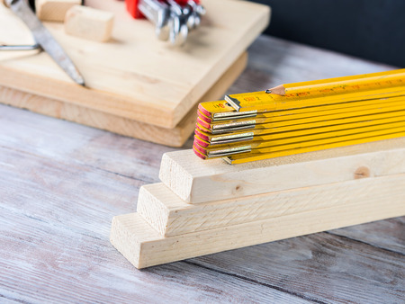 craft material: Wooden material pieces and measuring meter yellow pencil tools for bricolage diy hand made craft Stock Photo