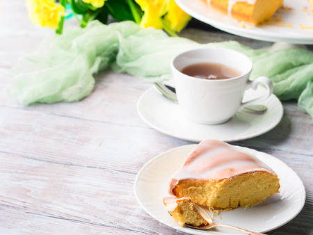 Bundt cake with sugar frosting. Spring breakfast set. Easter festive treat Stock Photo