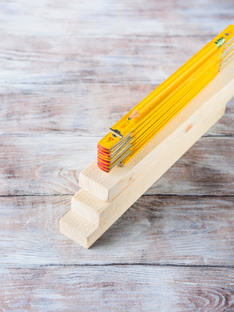 Wooden material pieces and measuring meter yellow pencil tools for bricolage diy hand made craft Stock Photo